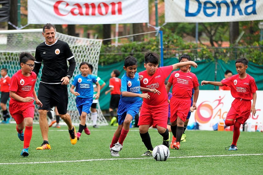 Children at the ActiveSG Football Academy coached by Aleksandar Duric (in black).
