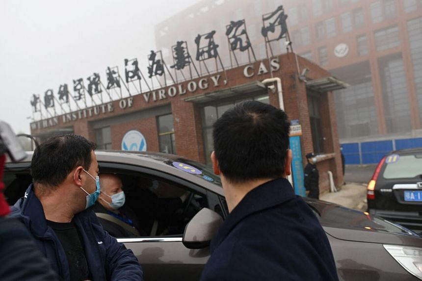 A photo taken on Feb 3 shows WHO members arriving at the Wuhan Institute of Virology.