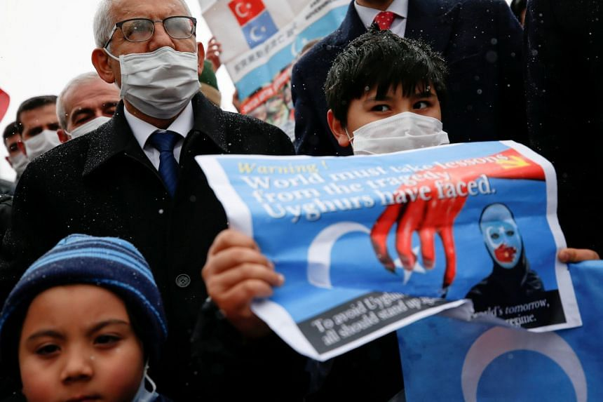 Ethnic Uighurs and activists protest against a visit to Turkey by China's State Councilor and Foreign Minister Wang Yi, on March 25, 2021.
