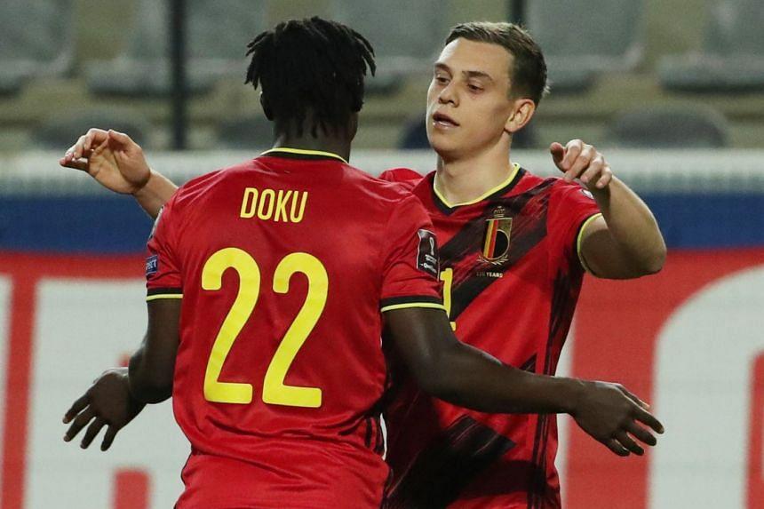 Belgium's Leandro Trossard celebrates scoring their seventh goal with Jeremy Doku.