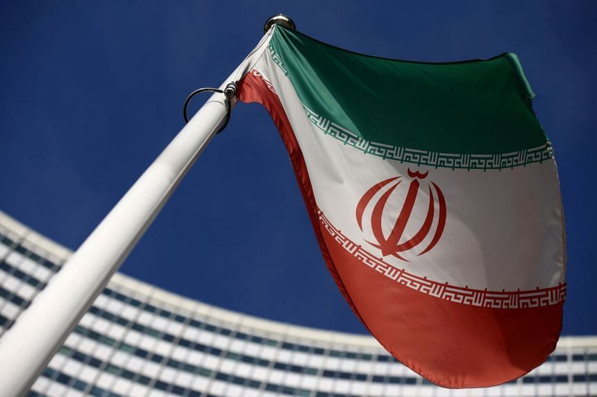 The Iranian flag waves in front of the International Atomic Energy Agency headquarters in Vienna, Austria.