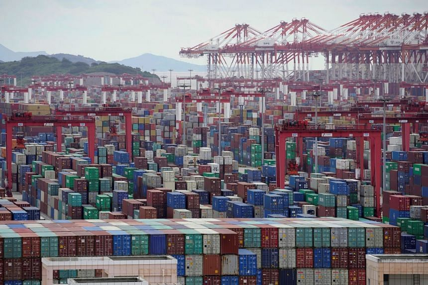 Containers are seen at Yangshan Deep-Water Port in Shanghai, China, on Oct 19, 2020.
