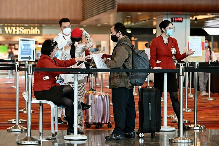 "Passengers at Changi Airport Terminal 1 late last year. The Ministry of Transport said it was looking to establish new travel arrangements with countries and regions which have ""successfully controlled the pandemic through surveillance and testing, c"