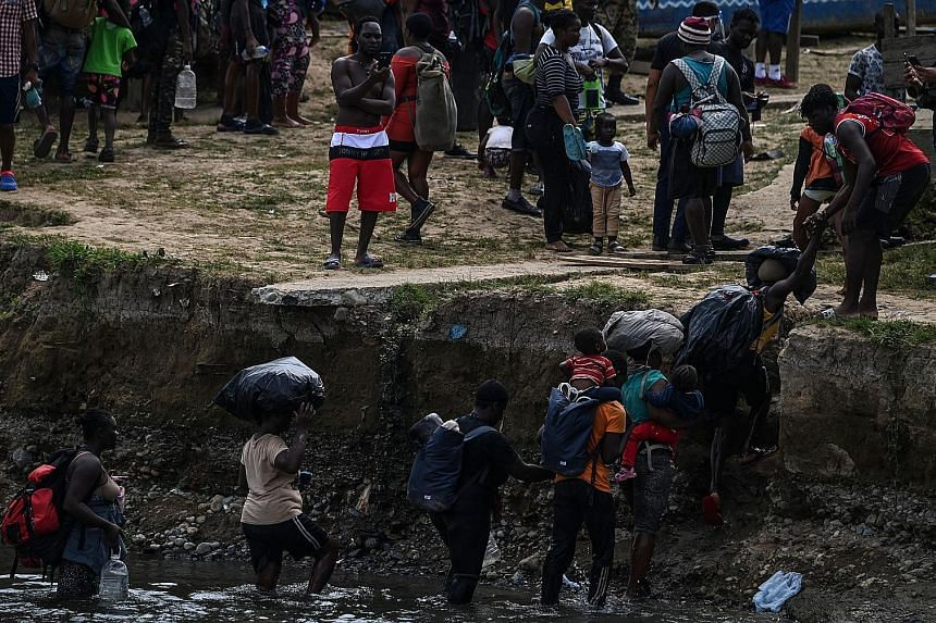 Migrants crossing the Chucunaque River last month after walking for five days in the Darien Gap jungle, Panama, on their way to the US. Over the past four years, more than 46,500 migrants, including 6,240 children and adolescents, have crossed the in