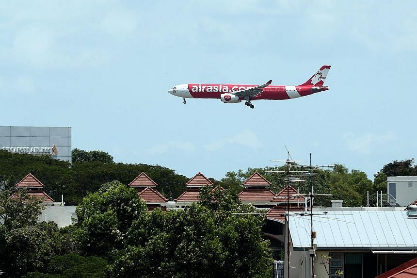 AirAsia Group reported a 90 per cent fall in passengers compared to a year ago, resulting in load factor, a measure of how full planes are, dropping 15 percentage points to 67 per cent. ST PHOTO: BENJAMIN SEETOR