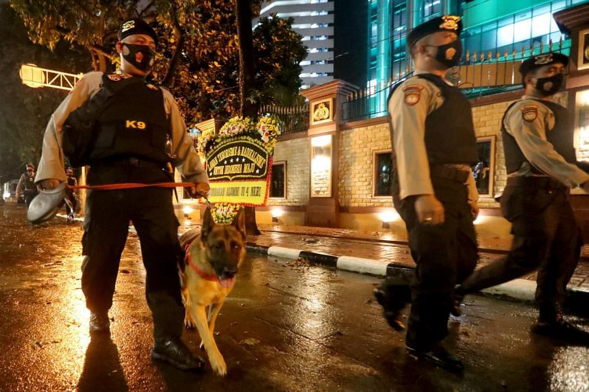 A K-9 unit patrolling following an alleged terror attack inside Indonesia's national police headquarters in Jakarta on March 31, 2021.