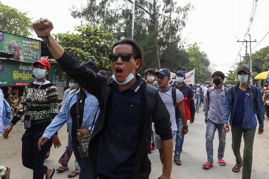 Demonstrators march during a protest against the military coup in Mandalay, on March 31, 2021.