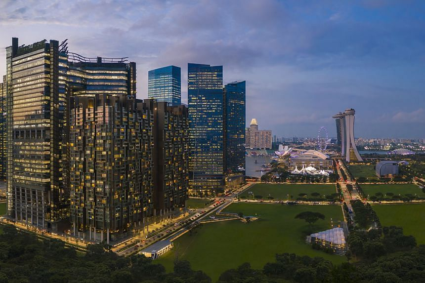 A view of Marina One Residences, a prime example of a mixed-use property development in Singapore's Marina Bay area, facing an iconic skyline.