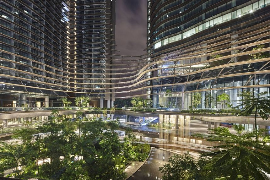"""Marina One Residences boasts sustainable features that add to lifestyle and well-being choices for property investors, such as a """"Green Heart"""" feature within the development."""
