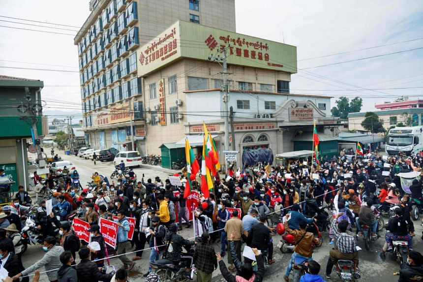 People taking part in a demonstration on Feb 8 in the town of Muse in Myanmar, near the China-Myanmar border.