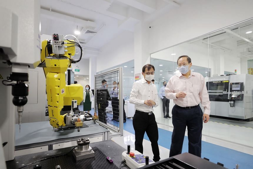 Second Minister for Trade and Industry Tan See Leng during visit to Sodick Singapore Techno Centre in the Jurong Innovation District on March 31.