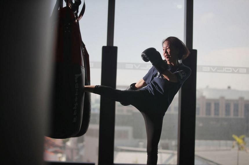 Ms Karen Chew picked up muay thai for self-defence and it has built up her confidence and strength in all aspects of life.