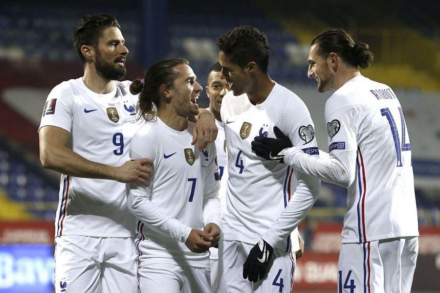 Griezmann (second left) celebrates with teammates after scoring against Bosnia & Herzegovina.