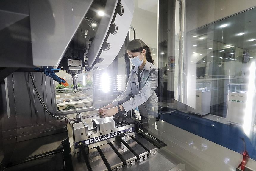 A worker at Sodick Singapore Techno Centre's manufacturing facility in Jurong. New industry guidelines for the safe set-up, operation and maintenance of additive manufacturing facilities were launched yesterday.