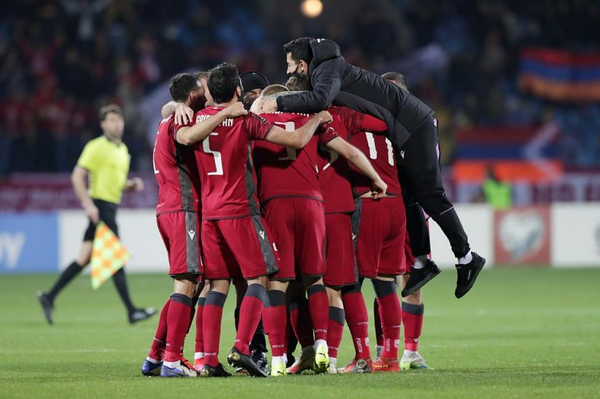 Armenia's players celebrating after defeating Romania 3-2 in their World Cup qualifying group match, on April 1, 2021.