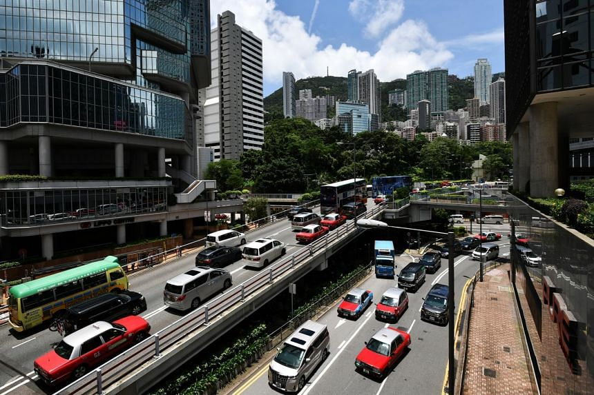 Hong Kong's moguls will lose more than 10 per cent of their votes to smaller businesses and mainland Chinese companies.