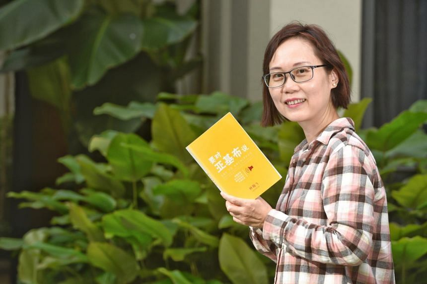 Ms Fong Wai Yee, who has benefited from the Translation Talent Development Scheme, holding a copy of a book titled Say To Archippus that she translated from English to Chinese.