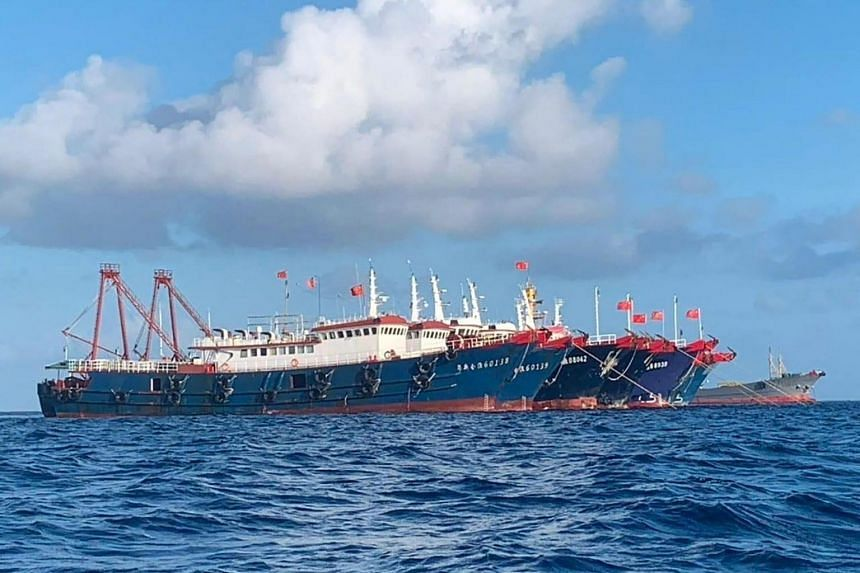 Chinese vessels anchored at Whitsun Reef, some 320 kilometres west of Palawan Island in the South China Sea on March 27, 2021.