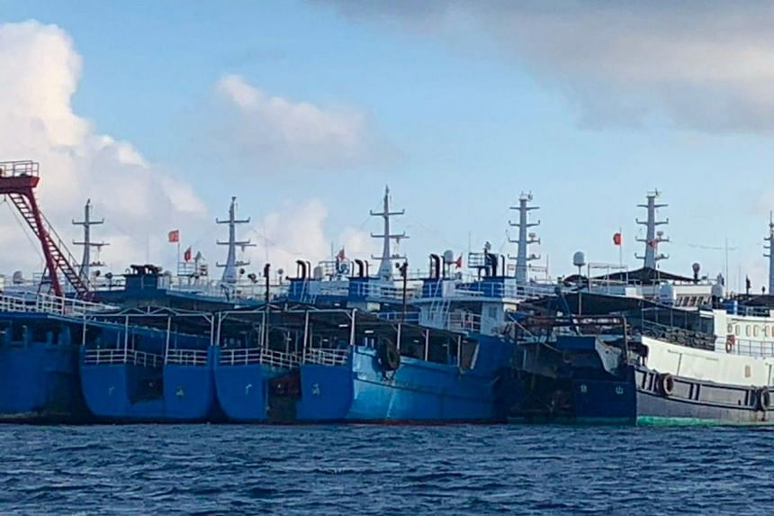 Chinese vessels seen at Whitsun Reef, in the South China Sea, on March 27, 2021.