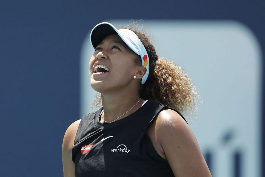 Osaka reacts against Maria Sakkari of Greece in their quarterfinal match.