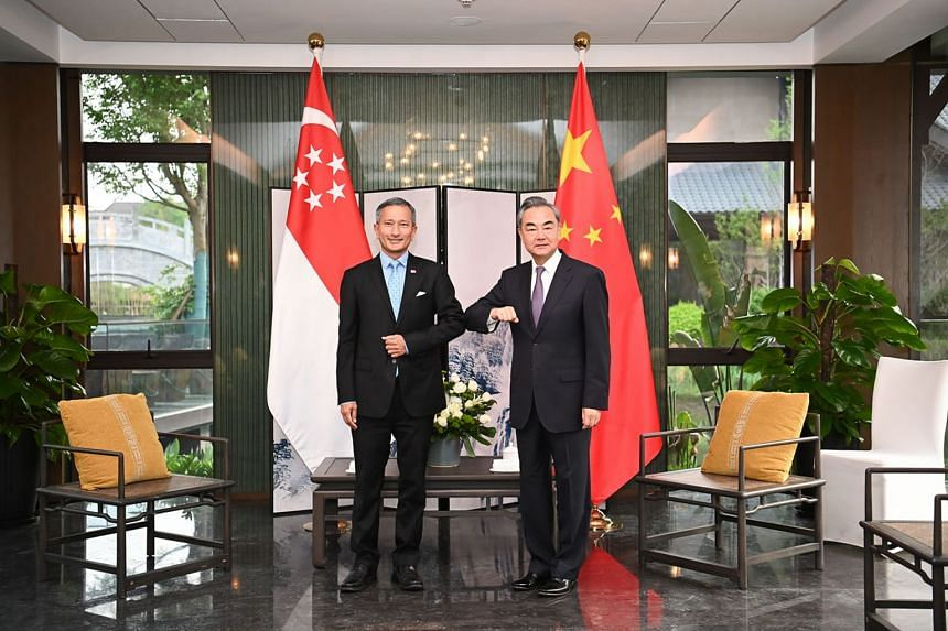 Dr Vivian Balakrishnan (left) meets with Chinese State Councillor and Foreign Minister Wang Yi, in Fujian, on March 31, 2021.