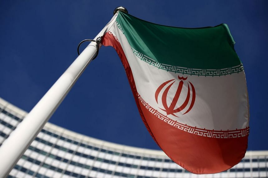 Iran's flag waves in front of the International Atomic Energy Agency headquarters in Vienna, Austria.