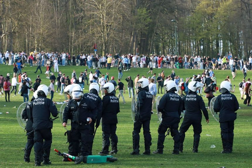 Belgian police forcefully disperse young people gathered in a Brussels park for an April Fool's Day party.