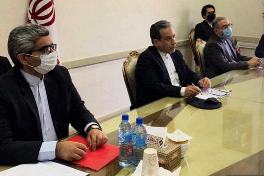 Iran's deputy foreign minister Abbas Araghchi (centre) attends a virtual meeting with the Joint Commission on Iran's nuclear programme (JCPOA) in Teheran, on April 2, 2021.