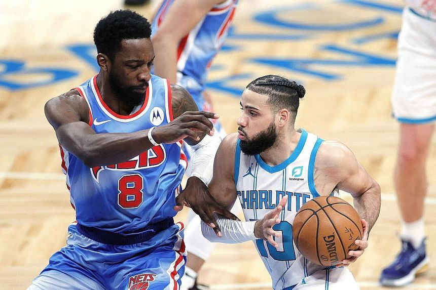 Brooklyn Nets' Jeff Green (#8) in action with Charlotte Hornets' Caleb Martin (#10) on April 1, 2021.