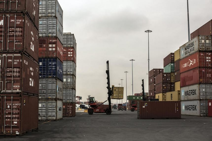Shipping containers are moved at the Port of Newark in Newark, New Jersey, on March 17, 2021.
