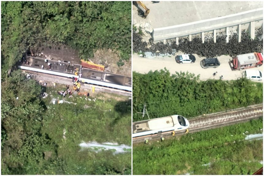 Rescue workers are seen by a train which derailed in a tunnel north of Hualien, Taiwan, on April 2, 2021.