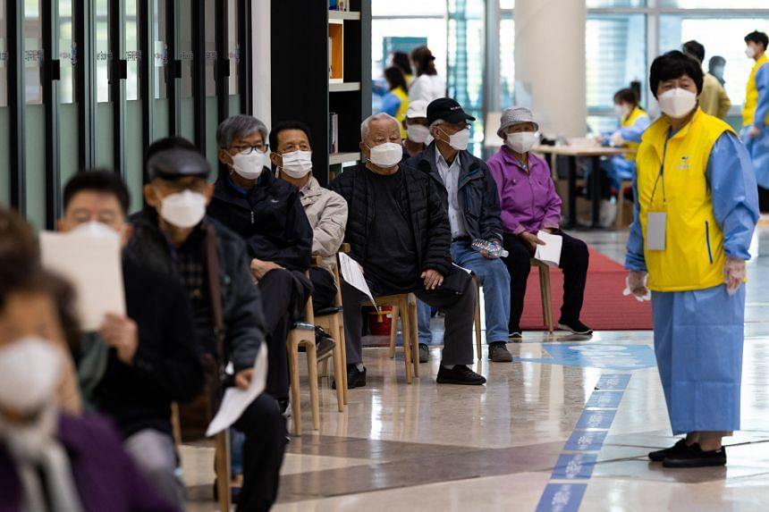 Elderly residents queueing to receive the first dose of the Pfizer vaccine in Goyang, South Korea, on April 1, 2021.