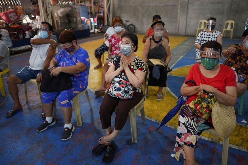 Senior citizens at an observation area after receiving their first dose of the AstraZeneca vaccination in Manila on March 29, 2021.