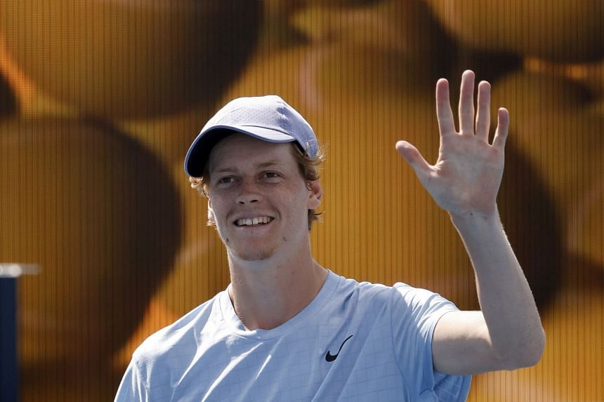 Sinner waves after defeating Roberto Bautista Agut of Spain.