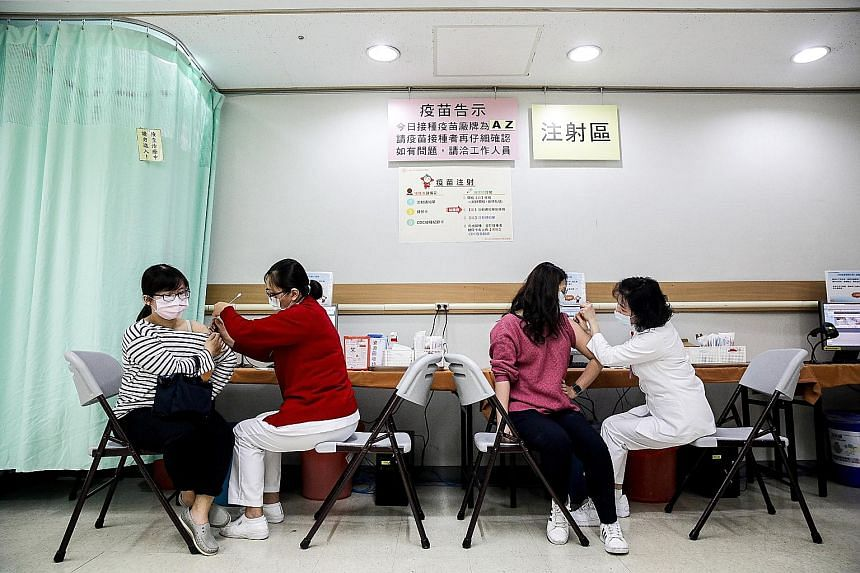 Healthcare workers in Taipei receiving the AstraZeneca jab on March 22, the first day of Taiwan's vaccine roll-out.