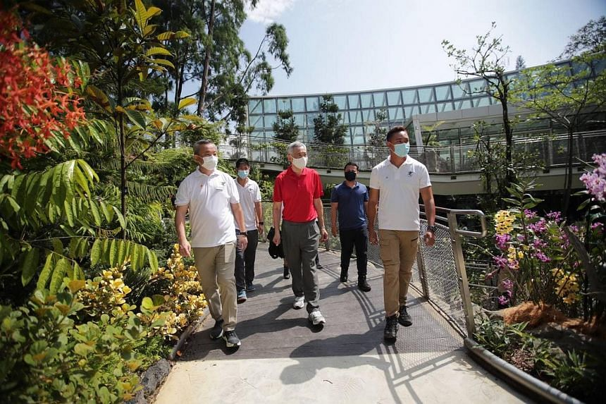 PM Lee Hsien Loong (centre) and Mr Desmond Lee (second from right) touring the Tropical Montane Orchidetum at the National Orchid Garden, on April 3, 2021.