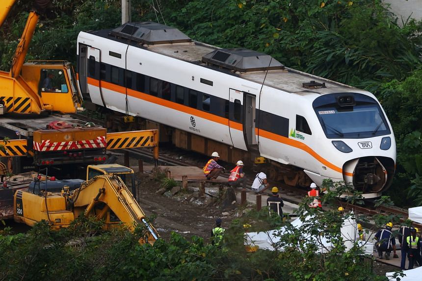 Rescuers working at the site a day after a deadly train derailment at a tunnel north of Hualien, Taiwan, on April 3, 2021.
