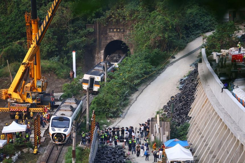 Rescuers work at the site a day after a deadly train derailment at a tunnel north of Hualien on April 3, 2021.