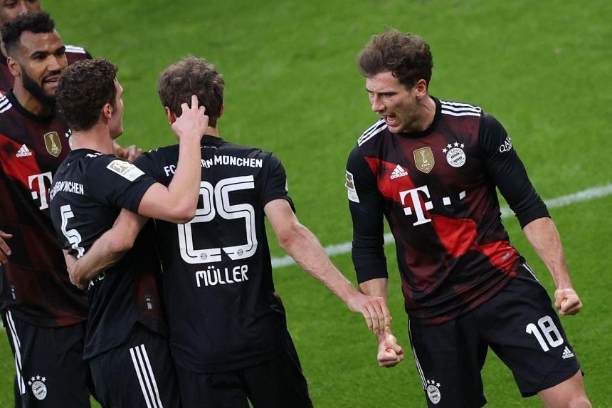 Bayern's Leon Goretzka (right) celebrates after scoring.