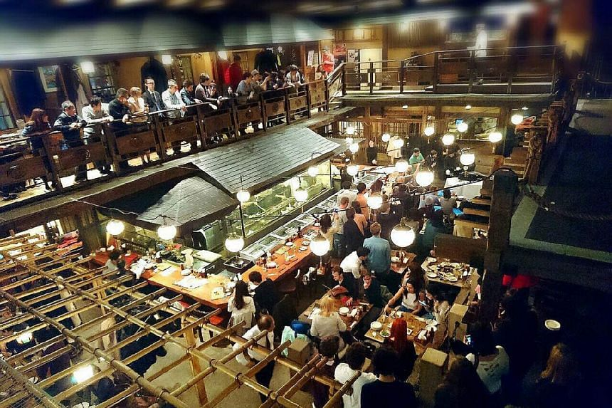 Unlike many other food and beverage businesses in Tokyo, Global-Dining's Gonpachi chain has resumed normal operating hours at its outlets, including the one in the Roppongi district (left), which inspired the backdrop of a scene in Quentin Tarantino'