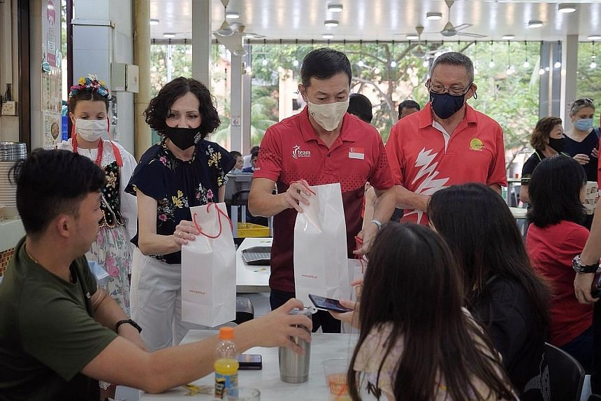 (From left) Poland's Ambassador to Singapore Magdalena Bogdziewicz, Sembawang GRC MP Lim Wee Kiak and Canberra Citizens Consultative Committee chairman Norman Aw distributing Polish eggs at a coffee shop in Sembawang Drive yesterday, ahead of Easter