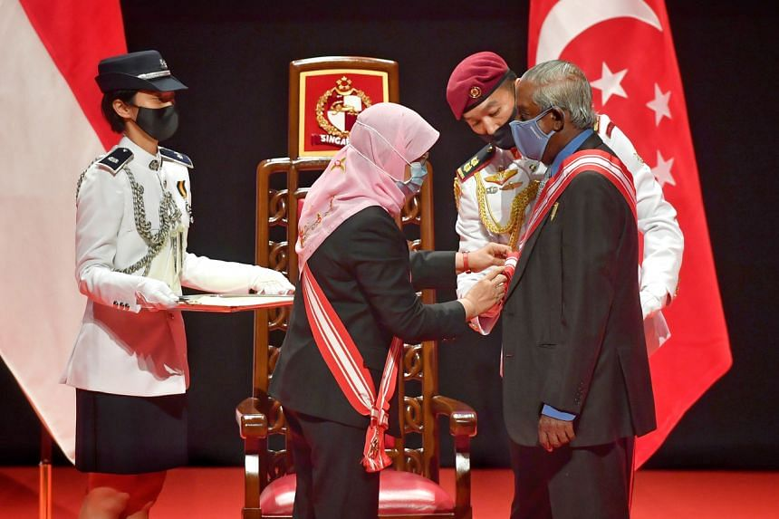 President Halimah Yacob (second from left) presents the Order Of Temasek (With High Distinction) to Professor S. Jayakumar at the investiture of the 2020 National Day Awards on April 4, 2021.