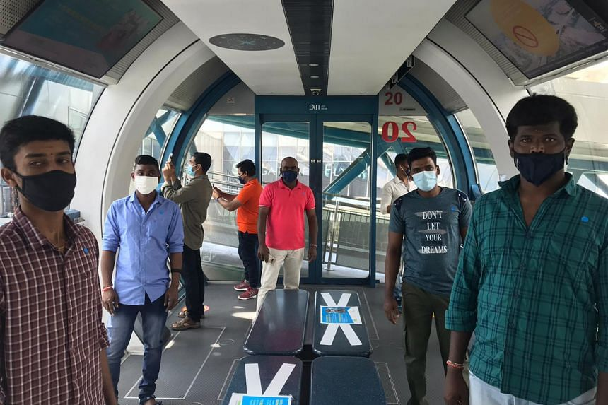 Migrant workers from construction company LC & T Builder enjoying a ride on the Singapore Flyer on March 28, 2021.