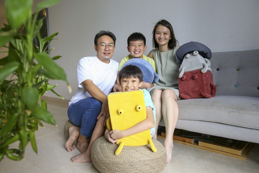 Mr Jeremy Aw and Ms Gladys Wong with their sons Delroy Aw, 12, and Delwain Aw, 10.