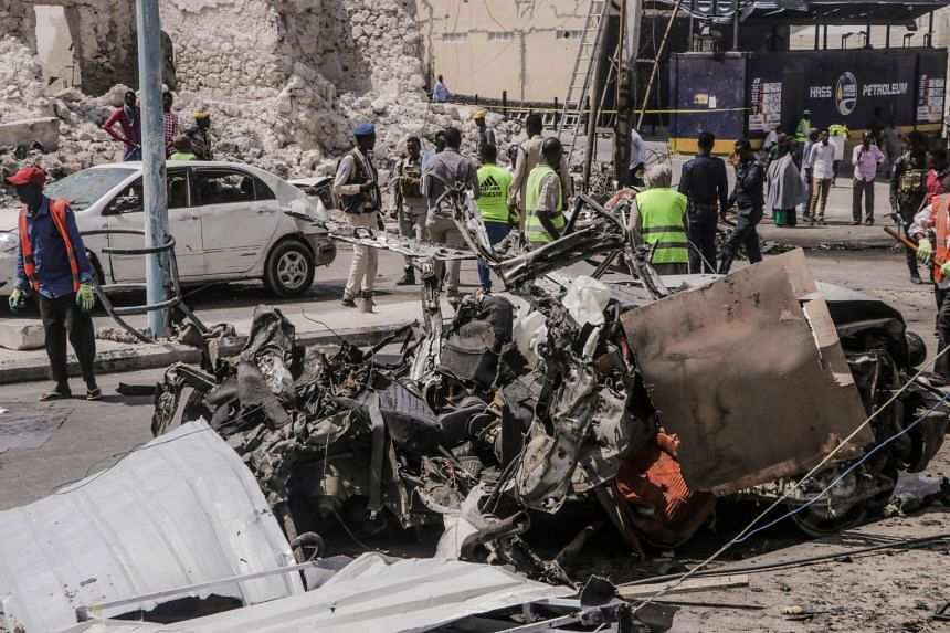 A February 2021 photo shows the aftermath of a suicide car bombing attack near a security checkpoint in Mogadishu.