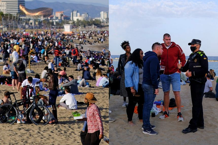 People spend time (rleft) at Barceloneta beach in Barcelona, Spain, while a police office speaks with tourists there (right).