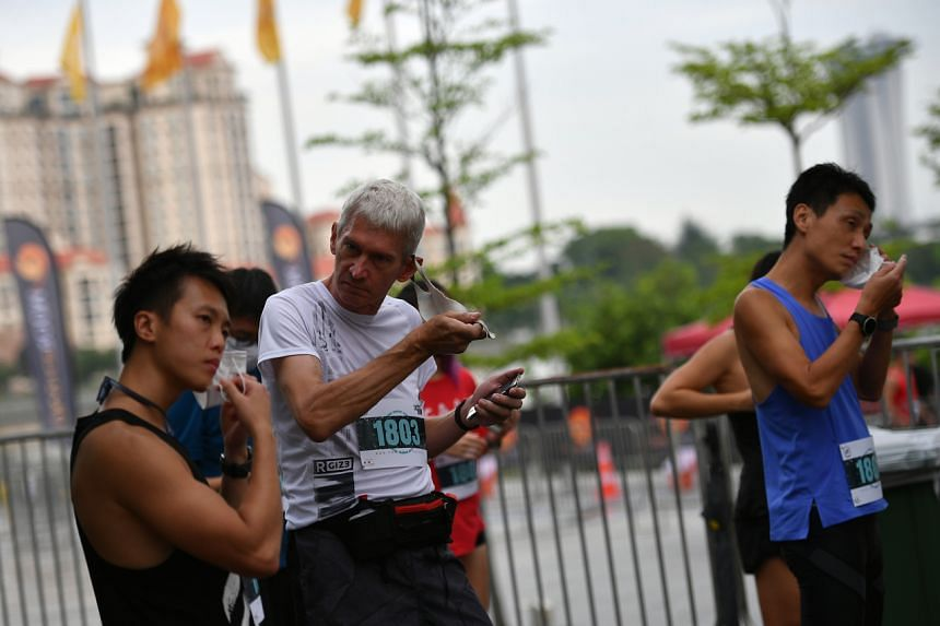 Runners were only allowed to remove their masks a few minutes before they were flagged off.