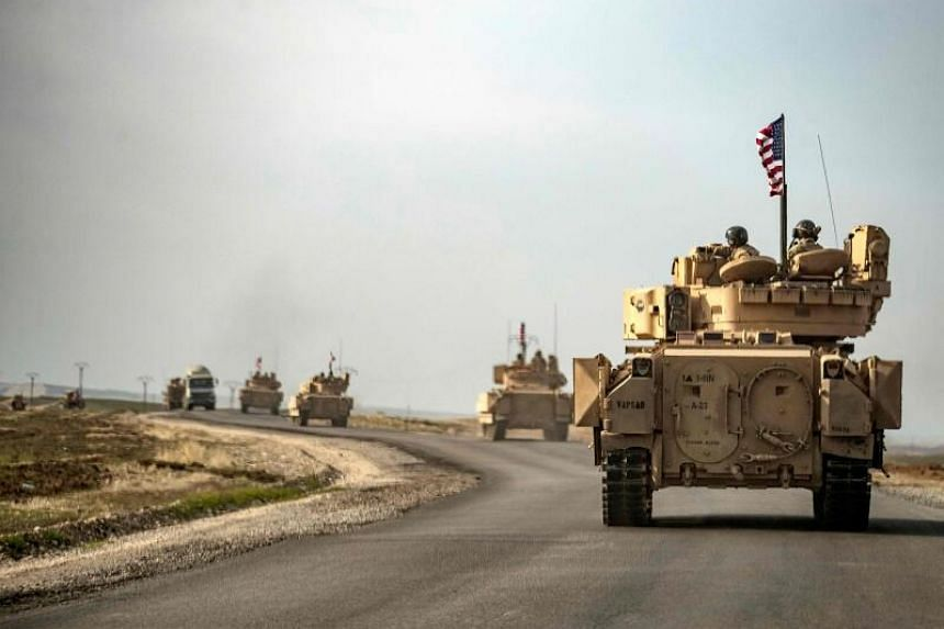 Two Americans and an Iraqi civilian have been killed in the attacks.