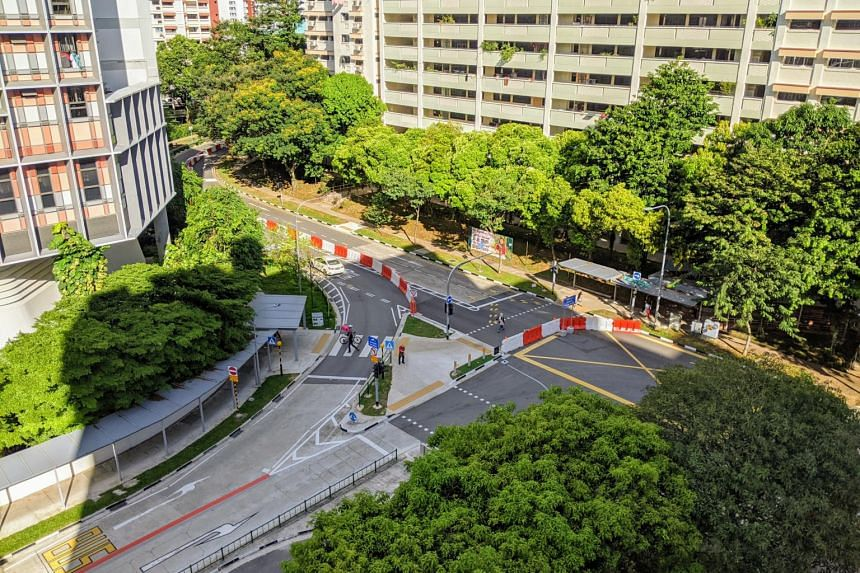 Barriers along the stretch of Woodlands Ring Road, turning one lane into a pedestrian path and the other into a bus-only lane.