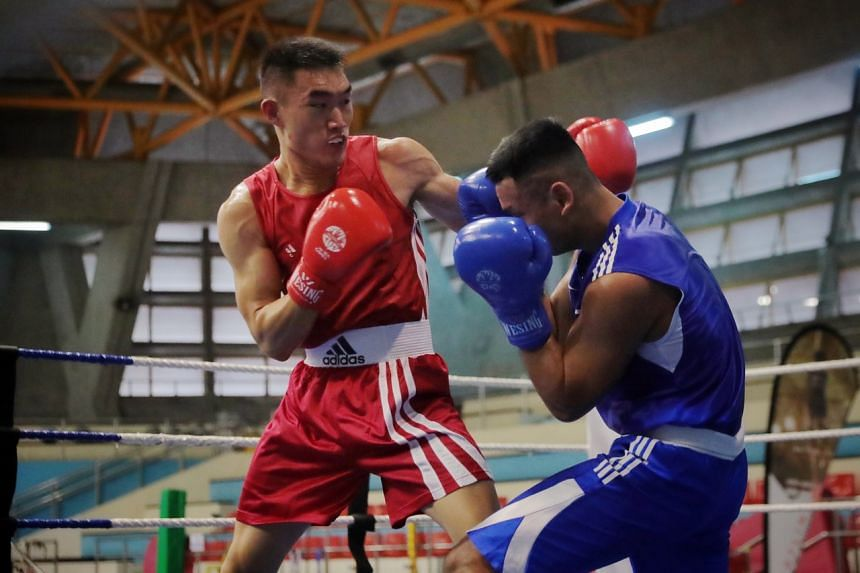 Velco Tan (left) competes against Danish Husli at the boxing Singapore National Championships, on April 4, 2021.